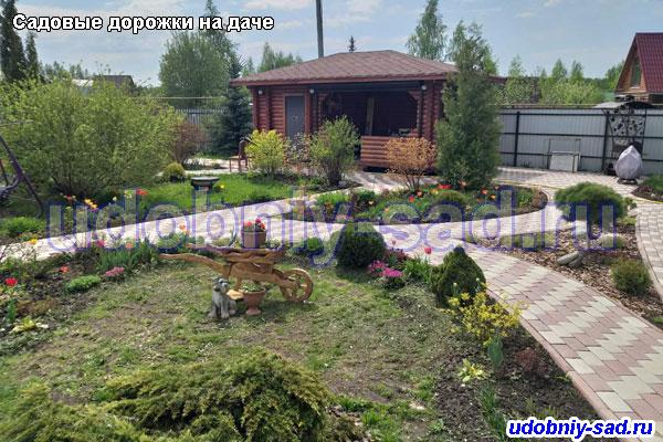 Укладка тротуарной плитки Английский булыжник на садовых дорожках в деревнеДергаево Раменского района Московской области